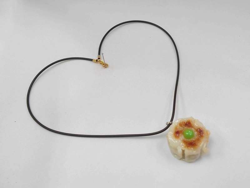 Steamed Pork Dumpling with Green Pea Necklace